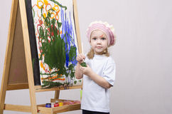 Girl artist paints on canvas Stock Photos