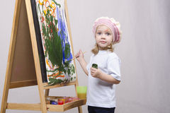 Girl artist paints on canvas Stock Photography