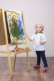 Girl artist paints on canvas Stock Photos