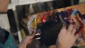Girl artist paints with oil painting. stock video footage