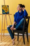 Girl artist paints sunflowers. Royalty Free Stock Image