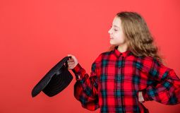 Girl artistic kid practicing acting skills with black hat. Enter acting academy. Acting school for children. Acting. Lessons guide children through wide variety stock image