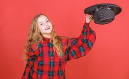 Girl artistic kid practicing acting skills with black hat. Acting school for children. Acting lessons guide children stock image