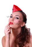 Girl with artistic makeup. Portrait of beautiful girl with artistic makeup and red hat on a head royalty free stock image