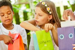 Girl as a birthday girl unpacks a gift royalty free stock image