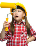 Girl as a construction worker with paint roller Royalty Free Stock Photography