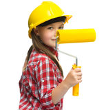 Girl as a construction worker with paint roller Royalty Free Stock Images