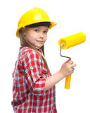 Girl as a construction worker with paint roller Stock Photography