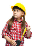 Girl as a construction worker with tape measure Stock Images