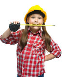 Girl as a construction worker with tape measure. Happy cute girl as a construction worker with tape measure, isolated over white stock photography