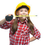Girl as a construction worker with tape measure Stock Photos