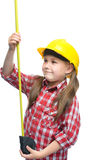 Girl as a construction worker with tape measure. Happy cute girl as a construction worker with tape measure, isolated over white stock photo