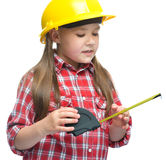 Girl as a construction worker with tape measure Royalty Free Stock Photography