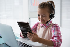 Girl as customer care executive smiling while working. In the office royalty free stock photo