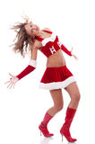 Girl as Santa dances Royalty Free Stock Images