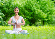 Girl in asana position prayer gesturing Royalty Free Stock Images