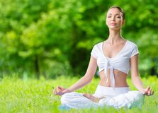 Girl in asana position zen gesturing Stock Photos
