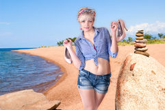 Girl ashore with shoes Royalty Free Stock Photo