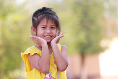 Girl Asian children look at camera and lollipop. Royalty Free Stock Photography