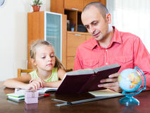 Girl asking father for help Stock Photo
