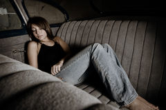 girl asleep in backseet of car Stock Photography
