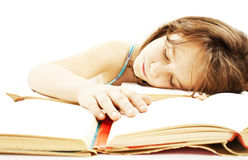 Girl asleep on the books Stock Photos