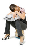 Girl asleep sitting on the books Stock Image