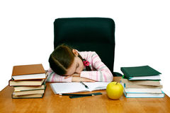 Girl is asleep at the writing table with books Royalty Free Stock Images