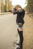 Girl assassin waiting for his victim on the road. royalty free stock image