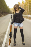Girl assassin waiting for his victim on the road. Royalty Free Stock Photography