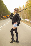 Girl assassin waiting for his victim on the road. Stock Image