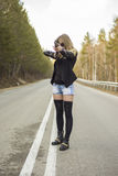 Girl assassin waiting for his victim on the road. Stock Images