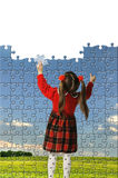 The girl assemble big puzzle Royalty Free Stock Image