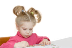 Girl assembling puzzles Royalty Free Stock Photo