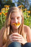 Girl with an aster Stock Images
