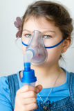 Girl with asthma inhaler Stock Photography
