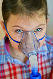 Girl with asthma inhaler Stock Images