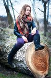 Girl astride on log. Young girl astride on log, outdoors, early spring day Stock Images
