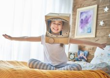 Girl in astronaut costume Stock Images