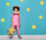 Girl in an astronaut costume Stock Photography