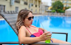 Girl At The Pool Drinking Cocktail Stock Image