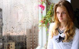 Free Girl At The Window In The Rain Royalty Free Stock Photography - 38434927