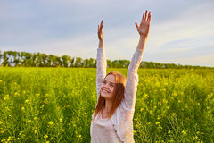 Girl At Yellow Seed Meadow Stock Photography