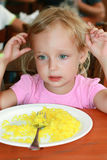 The girl ate the rice and no longer wants. Royalty Free Stock Image
