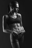 Girl athlete with athletic figure Stock Images