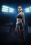Girl athlete with athletic figure Stock Photos