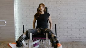 Girl athlete is engaged in the gym, in the fitness room. stock video footage
