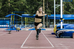 Girl athlete execution of triple jump Royalty Free Stock Images