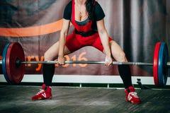Girl athlete exercise deadlift Royalty Free Stock Photos