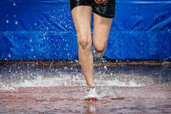Girl athlete foot running steeplechase Royalty Free Stock Photography